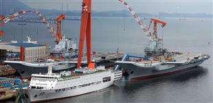辽宁舰将接受检修 首艘国产航母或再次海试